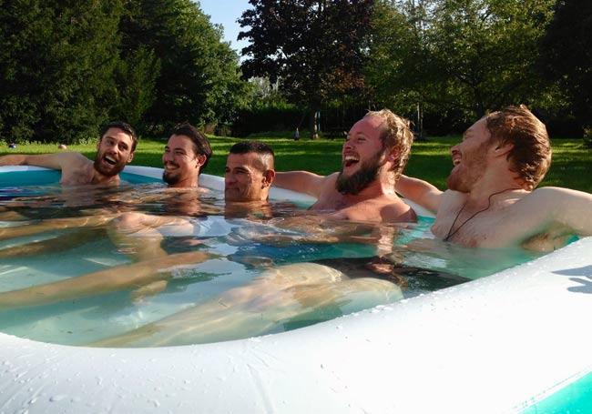 men in a paddling pool